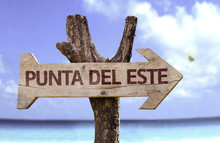 Punta Del Este Wooden Sign With A Beach On Background