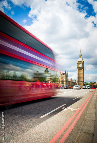 Photo  Red Bus crossing Westminster Bridge