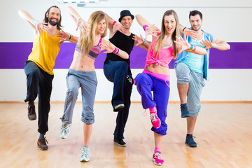 Fototapeta Dancer at Zumba fitness training in dance studio