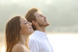 Leinwandbild Motiv Couple of man and woman breathing deep fresh air