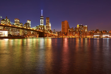 Fototapeta na wymiar Brooklyn Bridge with lower Manhattan skyline at night
