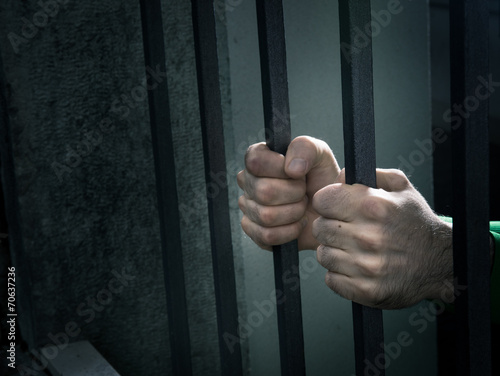 Fotografie, Obraz  Man in jail hands close-up