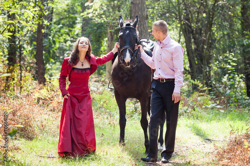 Poster Equitation happy couple and horse