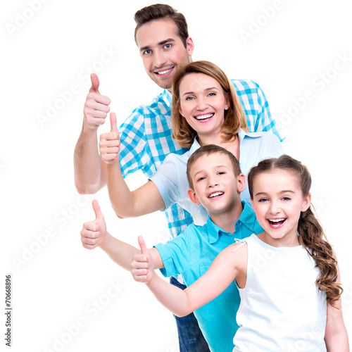 Valokuva  happy european family with children shows the thumbs up sign
