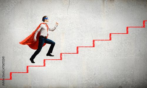Foto op Aluminium Dance School Superman on ladder