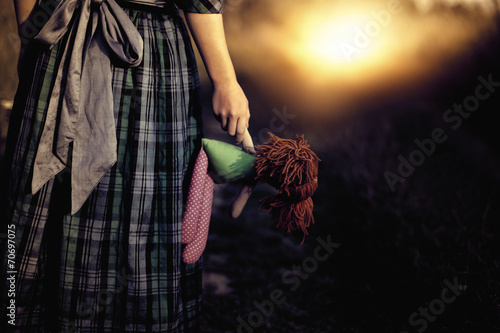 Photographie  Loneliness - the girl with the doll goes to the light
