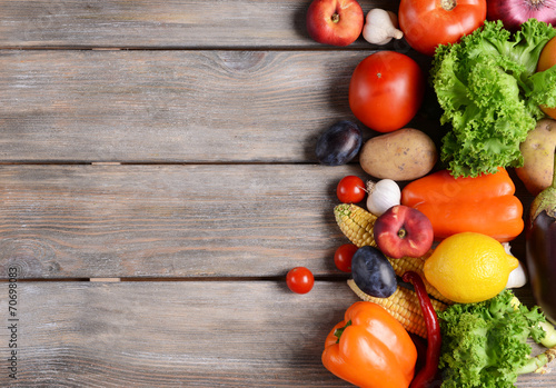 Poster Cuisine Fresh organic fruits and vegetables on wooden background