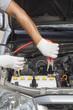 mechanic working in auto repair shop.