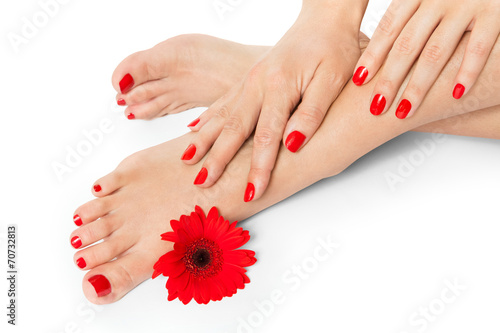 Poster Pedicure Woman with beautiful red manicured nails