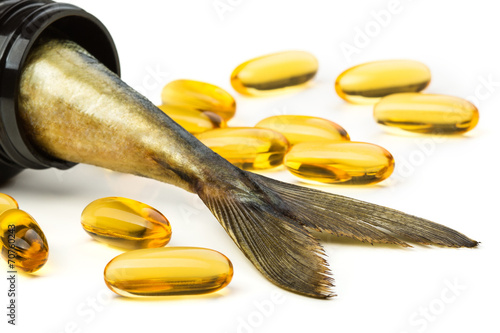 Fish oil capsules and fish tail in brown jar Canvas-taulu