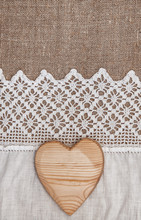 Burlap Background With Lacy Cloth And Wooden Heart