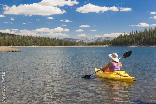 Fotografie, Obraz  Woman Kayaking on Beautiful Mountain Lake.