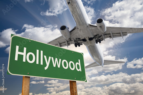 Photo  Hollywood Green Road Sign and Airplane Above