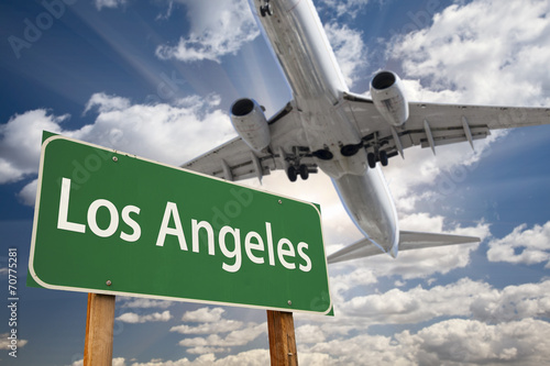 Los Angeles Green Road Sign and Airplane Above
