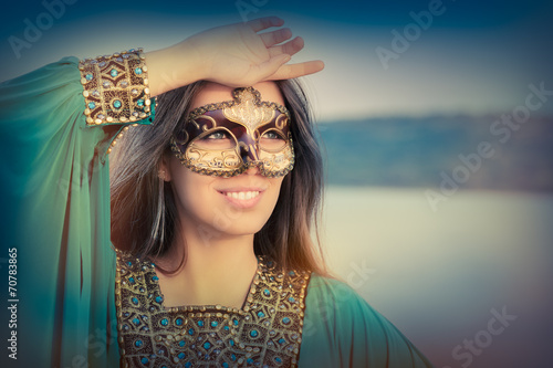 Young Woman Wearing Mask  and Oriental Dress