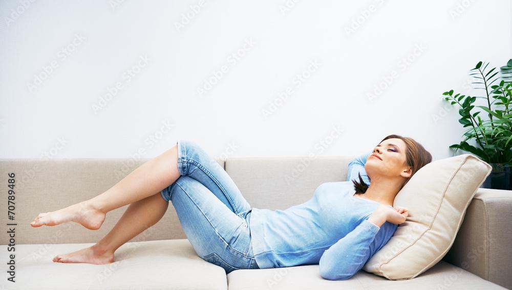 Fototapeta Woman relaxing at home.