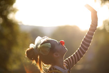 Portrait Of Beautiful Clown Girl Taling Photo, Outside