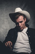 Retro fifties cowboy rebellion fashion man wearing white hat and