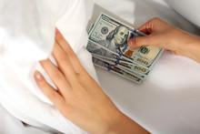 Woman Hiding Money Under Pillow At Home