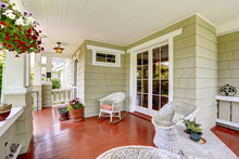 Entrance Porch With Wicker Cha...