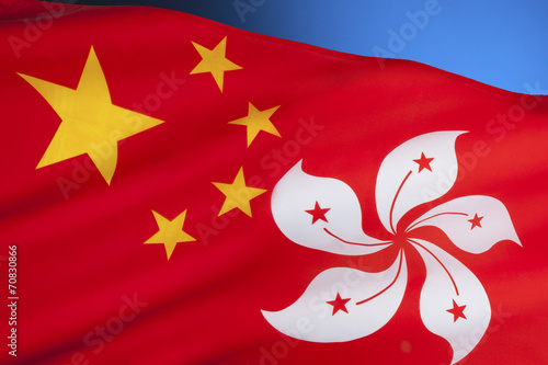 In de dag China Flags of the Peoples Republic of China and Hong Kong
