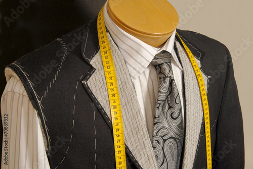 Fotografie, Obraz  Tailor shop mannequin with measuring tape across neck.