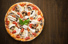 Pizza With Chicken And Mushrooms On Dark Wood Background
