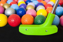 Colorful Golf Balls With Green Club