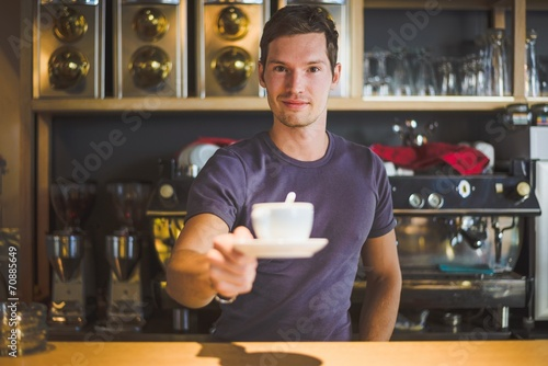 Fotografie, Obraz  Waiter holding coffee cup