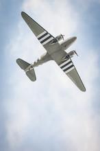 Vintage Propeller Aircraft Against A Blue Sky