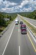 Semi-Trucks Travel Down The Interstate