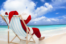 Santa Claus Sitting On Beach C...