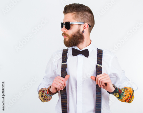 Fotografie, Obraz  portrait of a stylish hipster holding his suspenders