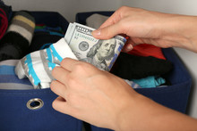 Woman Hiding Money In Sock Clo...