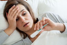 Woman With Fever In Bed