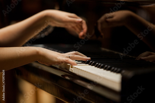 Fotografie, Obraz  Woman's hands on the keyboard of the piano closeup