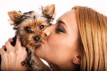 Beautiful Blonde Woman Kissing Yorkshire Terrier - Close Up