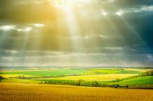 Sun Rays Through Dark  Clouds Over  Fields, Landscape