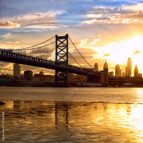 Philadelphia skyline and Ben Franklin Bridge at sunset, US