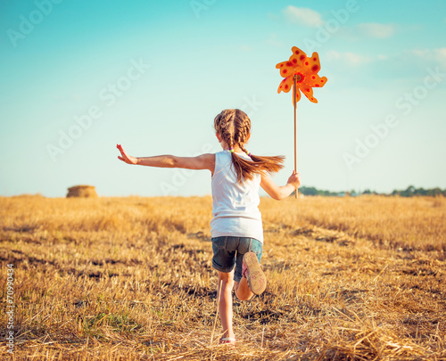 Fotografia, Obraz  cute little girl with a  windmill