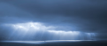Sunlight Goes Through Blue Stormy Clouds. Bay Of Tangier, Morocc