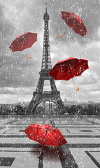 FototapetaEiffel tower with flying umbrellas.