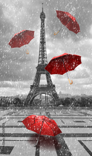Obraz Eiffel tower with flying umbrellas. - fototapety do salonu