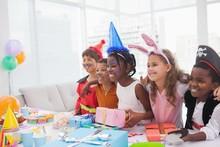 Happy Children At Fancy Dress Birthday Party