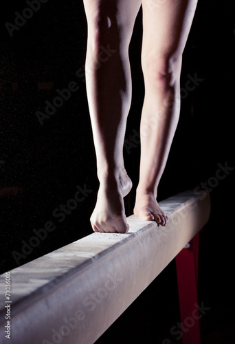 feet of gymnast on balance beam Poster