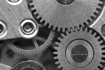 Fototapeta Black white background with metal cogwheels a clockwork. Concept