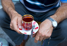Man Holds A Cup Of Hot Turkish Tea