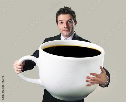 Fotografie, Obraz  businessman holding oversized cup of black cof