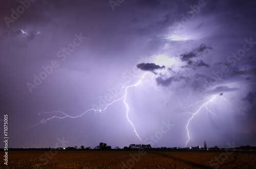 Poster Onweer Storm with lightning in landscape