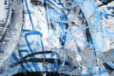 Fototapeta Młodzieżowe - Abstract blue graffiti fragment on gray urban concrete wall